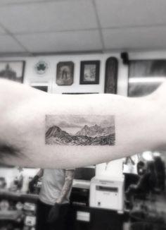 Single needle mountain landscape tattoo by Doctor Woo