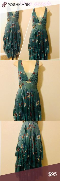 Free people boho Floral Gown In great condition  Size 6 Teal with hints of brown and fuchsia Silk like material Very flowy and full dress Excellent for the spring and summer  Can be casual or for special events Free People Dresses Maxi