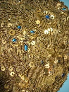 Detail of the Gold Metallic Embroidery on a Child's Cap.