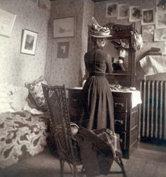 Love this sepia photo of a vintage young lady in her room, preparing to go out.