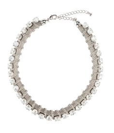 Short, adjustable metal necklace with rhinestones and a clasp at back. HandM
