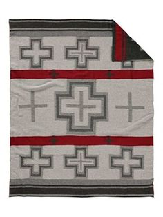 Curl up in this soft, warm throw blanket in a striking jacquard knit. Perfect for dozing off or draping across the sofa. Our vibrant San Miguel pattern was inspired by mid-to-late 19th-century Native American weaving traditions and the influence of Spanish missionaries in the Southwest. - Pendleton Woolen Mills - National Cowboy Museum