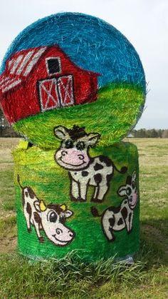 Painted hay bales by Cyndi McKnight at Hill Ridge Farms, spring 2015