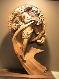 Alphonse Mucha. Talla en madera. Woodcarving.