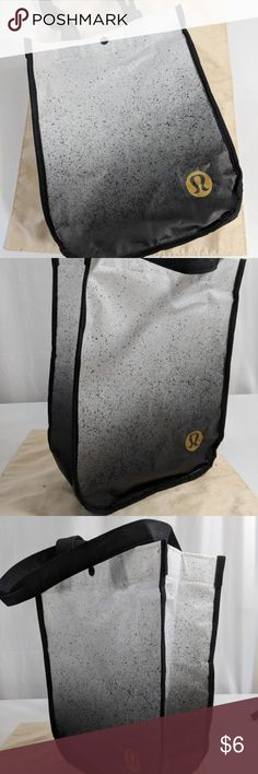 """NEW Lululemon Athletica Reusable Shopping Bag Lululemon Athletica reusable shopping bag. Brand new, never used. Size small. Color black and white with golden lululemon logo. Snap button on top. Measurements 11.5""""x 9""""x 4"""".   Remember to bundle up and save more, so check my closet for other treasure finds. lululemon athletica Bags Totes"""