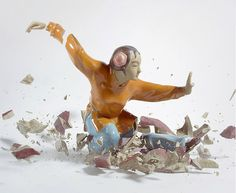 Crashing porcelain action figures by martin klimas. More images on his website - nice.