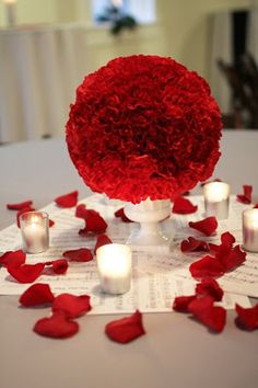 Sheet music and carnation centerpiece. Don't care for the red, but would be nice with pastels.