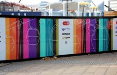 TFL multicoloured construction hoarding. Bespoke hoarding idea