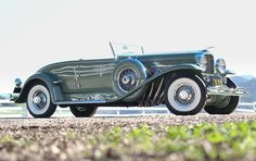 "1933 Duesenberg Model J Disappearing-Top Convertible Coupe. Yup...died and went to ""Duessy Heaven"". Love...sigh"