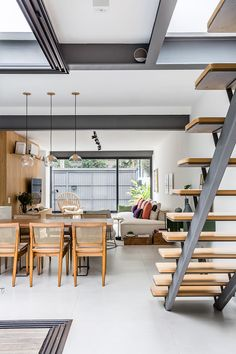 The architect uses a contemporary interior design and simultaneously maintain all memories of the old village house in this house. All created designs for the interior and exterior of the house can cr Industrial Kitchen Design, Kitchen Design Open, Loft Stairs, House Stairs, Patio Interior, Interior Stairs, Interior Ideas, Narrow House, Metal Homes