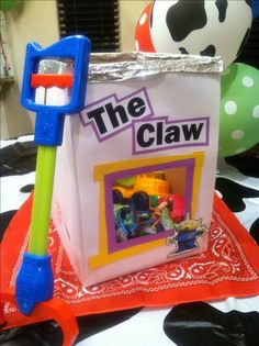 Toy Story Party Game: The Claw.  Fill paper-covered box with toy prizes for the kiddos to fish out with a claw grabber.