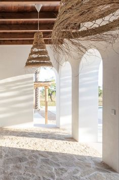 Ibiza Style porch lamps made of straw, white washed walls and wooden beams ceiling