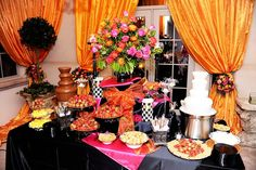 LDS wedding reception.   Orange, Pink and Black theme dessert buffet with Chocolate fountains. Photo by Tami Webb Photography.  WeddingLDS.com