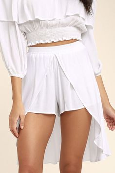 Happily ever after starts with the Lucy Love Love Story White Skort! Gauzy woven rayon creates a breezy high-low silhouette atop shorts with an elasticized waist.