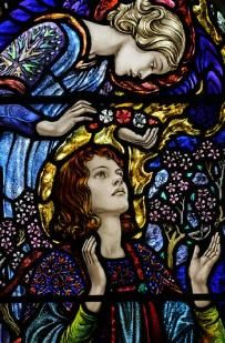 One of several Pre-Raphaelite stained glass windows, for which Waterford church is famed, by William Morris in St Michael and All Angels Church in Waterford, near Hertford.  Here: an angel bends over St Cecilia