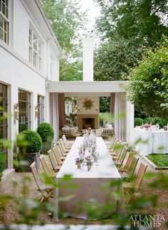 Boxwood in planters, fine dining al fresco, outdoor fireplace