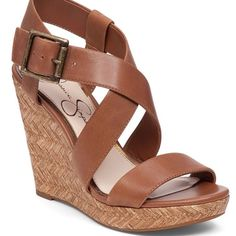 """Cute tan wedge by Jessica Simpson These are so adorable! Love them, but they are a bit too narrow for my feet :( Excellent, like new condition. No signs of wear, only on bottoms. Runs true to size, excellent quality! Retailing right now at Dillard's for $60!       From Jessica Simpson, the Joilet sandals feature: leather upper ankle strap with adjustable metal buckle closure basket weave platform and heel rubber outsole 0.78"""" platform; 4.1"""" wedge heel; feels like a 3.32"""" wedge heel Jessica…"""