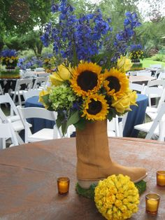 Western Theme Table Decoration Ideas | love the flower-in-a-boot idea from The Flower Studio.