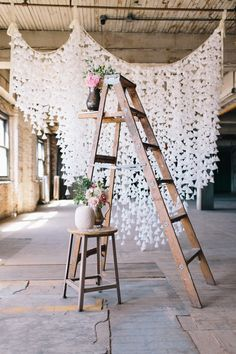 #backdrop, #ladder  Photography: Allie Rae Photography - www.allieraephoto.com  Read More: http://www.stylemepretty.com/2013/09/27/diy-wax-paper-backdrop/