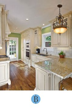 get rid of two windows, do one over sink, and go with this layout. Love the counter height wide bar. Thinking of doing that instead of taller height bar. Neutral Cabinets, Traditional Kitchen, New Kitchen, Kitchen Remodel, Green Walls, Remodels, Layout, Flooring, Kitchen Planning