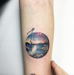 Detailed circular landscape tattoo by Eva Krbdk