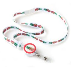 "The multicolored pineapple design featured on this fashionable ribbon lanyard produces a piece that is boasting with quirkiness, playfulness and vibrancy. Each fabric lanyard is also finished with a round detachable badge reel that offers a 27"" retractable cord, allowing you to convert it according to your specific needs."