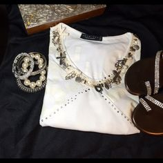 Gorgeous Twin Set Simona Barbieri Love Top. Over the top beautiful & Uniquely Cool. Twin Set Simona Barbieri tee. White with Love in bust area in cream. Dramatic charms hang from neckline with studs. Ties in back for a fotm fitted look. Lots of stretch. Tag is missing because of me. Itched my side. I'm sure cotton/spandex. I have only worn this top one time. It is so cute and sexy. Made in Italy. Size M. Too big for me. Love. Twin Set Simona Barbieri Tops Tees - Short Sleeve
