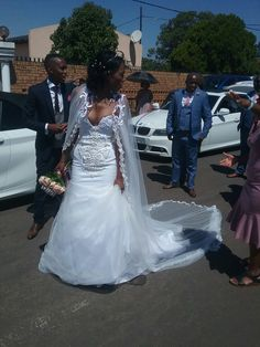 Bride in custom Zene pristine South Africa gown and tulle cape