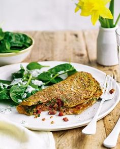 Chetna Makan has spiced up a classic omelette, topped it with spinach, then finished it with a soured cream dressing – making it the perfect midweek breakfast or Sunday brunch recipe.
