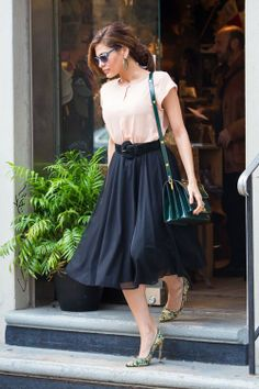 Eva Mendes in New York City, 22 October 2013. Wearing: Eva Mendes Collection for New York & Company - Fiona Skirt ($59.95) | Bionda Castana Lace Daphne Bis Pumps in Green ($713) | Marni Top Flap Triple Gusset Shoulder Bag ($1,460)