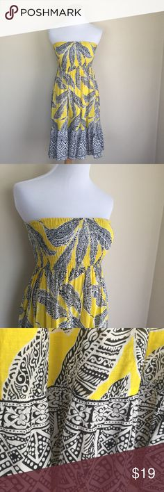 Steve Madden strapless tropical sundress sz L Steve Madden strapless tropical print sundress. Tag size L, this runs small for size, follow measurements for fit. Smocked stretch bust, full skirt with bottom ruffle, lined from bottom of bust to top of ruffl