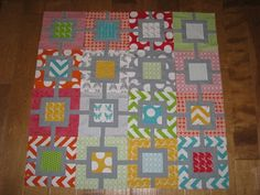 Quilt made with 1 charm pack, 1 jelly roll & 1 solid