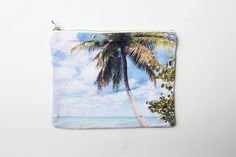 https://quarterly.co/products/nina-garcia  Carry them in your canvas palm tree print clutch created by Print All Over Me. Its summery pattern makes it the perfect pouch to hold all of your summer essentials this year.