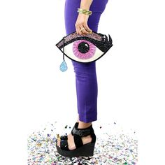 A Dali inspired eye shaped small handbag.    The glitter eyes iris has 2 shades of pink, with a rainbow glitter eyelid and features a blue glitter