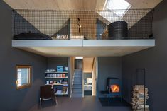 Dubbed Holzhaus am Auerbach, this holiday home has been designed by its owner-architects, Christine Arnhard and Markus Eck. The house is set in a small vil Small Wooden House, Narrow House, Interior Design Examples, Interior Design Inspiration, Daily Inspiration, Cabin Chic, Contemporary Cottage, European House, House Built