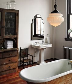 love the antique style of this bathroom with the freestanding wood hutch Upstairs bath!