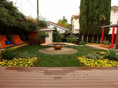 Color and more color have been added to this once barren yard.  Not to mention, a lot more  function and style. Benches were incorporated in the wall of bougainvillea creating a perfect nap spot or plenty of seating for a party.