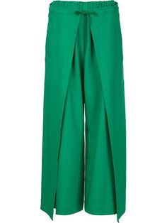 Shop Issey Miyake wrap palazzo pants  in H. Lorenzo from the world's best independent boutiques at farfetch.com. Shop 400 boutiques at one address. Wrap Pants, Skirt Pants, Trouser Pants, Wide Leg Trousers, Pantalon Thai, Pantalon Large, Fashion Pants, Hijab Fashion, Fashion Dresses