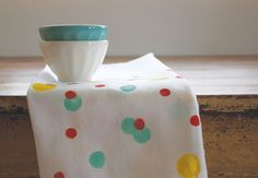 Flour sack dishtowels are my absolute favorite to use in the kitchen. They are absorbent and dry quickly. The problem? They don't add much to the room as far as color goes. My solution is to add a bit of paint and fabric medium to customize the towels to your specific taste and color scheme. …