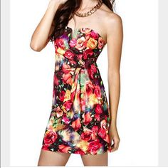 Nasty Gal Floral Dress Nasty Gal floral dress. Bright, vibrant flowers make this dress a head turner. Has boning that supports the v notched neckline. Has sash detail that I tied at my waist. I bought it for a wedding and changed my mind last minute. Never worn out of my apartment. Nasty Gal Dresses Prom