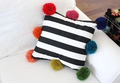 DIY pompom pillow- super fun &easy!!! Thinking Sophie's  bedroom!