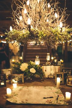 rustic candlelit guestbook display, love the chandelier! // photo by Lindsey Johnson // http://ruffledblog.com/mint-springs-farm-wedding