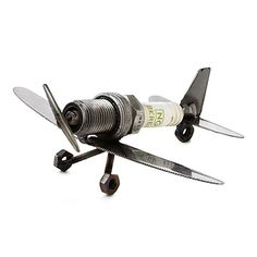 SPARK PLUG PLANE PAPERWEIGHT This mini sculpture is made from recycled tools that are welded together into the shape of an airplane. $ 35.00