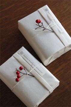 The red berries pop against the white paper. Imagine a stack of these gifts under a tree. So striking!