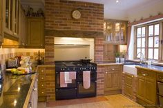 #Kitchen Idea of the Day: Country Kitchens. Brick fireplace style range hood.