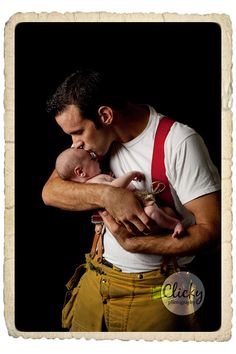 Fireman Daddy with his newborn baby..(: