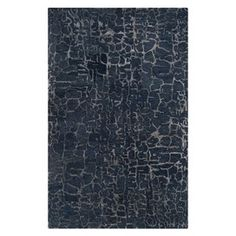 Ava Rug in Sapphire Blue. What a cool look for a rug and if it was against a gray tile or cherry red wood floor!
