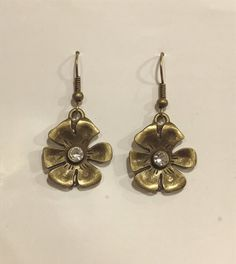 Gold brushed flower earrings by TheCraftyCarvalho on Etsy