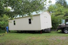 Crafty Gemini has a 12' X 28' custom built shed for her sewing studio. Many pictures at the source as well as a video tour.