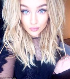 Glamorous: Perrie also sported sultry makeup and a stylish lace top in another selfie...